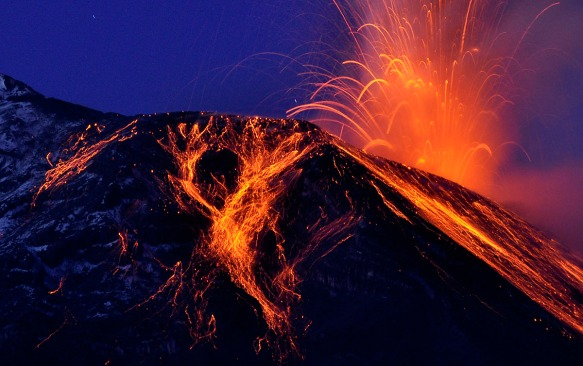 Lava streams at night. Photo: Lou Jost.