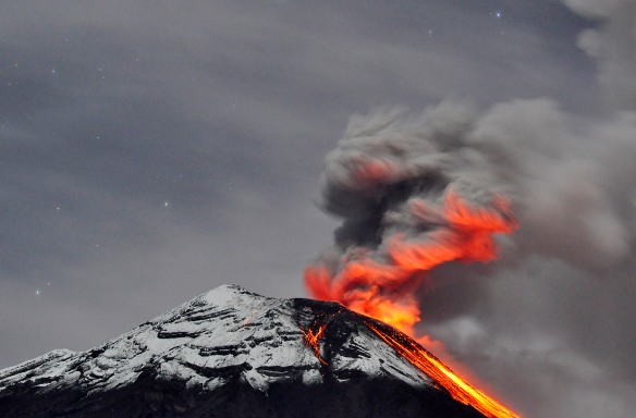 Eruption over snow, with the lava glow reflected in the ash cloud. Long exposure on a moonlit night. Photo: Lou Jost.