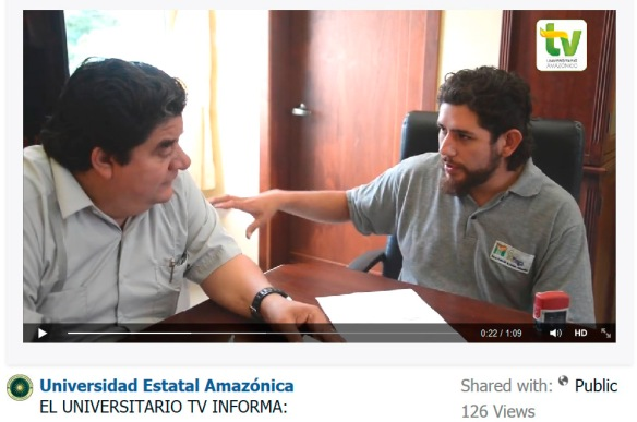 The rector of the Universidad Estatal Amazonica, Dr Julio Cesar Vargas (left) and EcoMinga's Juan Pablo Reyes sign a five-year agreement of scientific and educational cooperation in Puyo last week.  A screen capture  from the Universidad Estatal Amazonica's TV channel; click here for the video. announcement.