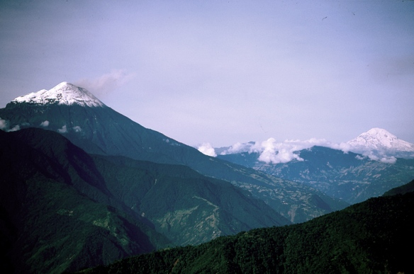 The view from near the top of Cerro Mayordomo, looking southwest towards Volcan Tungurahua, the snow-capped peak on the left, and Chimborazo, the snow-capped peak on the right. Chimborazo is the highest point on earth, higher than Everest in terms of distance from the earth's center. Photo: Lou Jost.