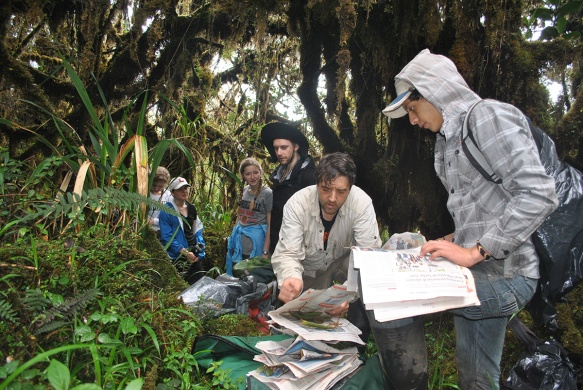 John and Darwin processing the collections of plant specimens in the quarter-hectare plot. Photo: EcoMinga staff.